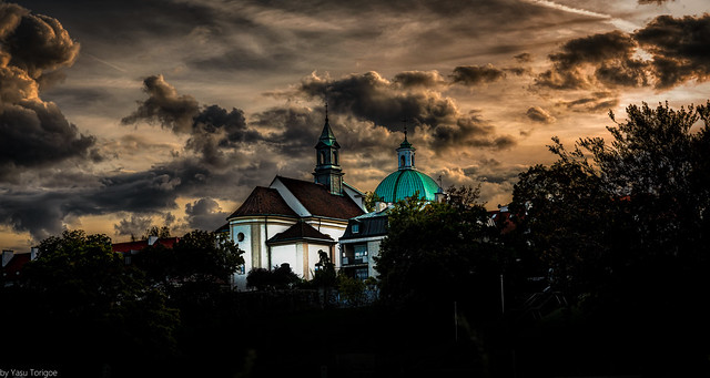 Sunset view of the Church of St. Benon and dome of the Roman Catholic Church of St. Casimir in New Town, Warsaw, Poland.  030 a