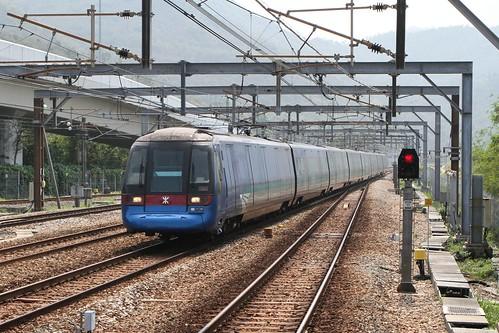 Hong Kong bound Airport Express train runs through Sunny Bay station
