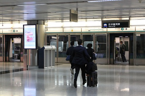 Passengers board a train to the city at Airport station