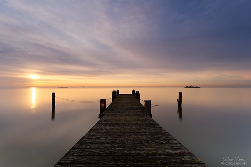 sunrise serene lake markermeer netherlands water jetty reflection nikon d7500 uitdam serenity waterscape landscape sky cloud pole le longexposure