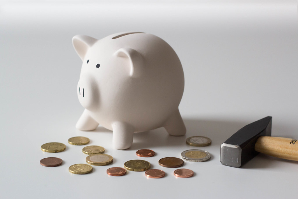 Close Up Photo of Piggy Bank with Hammer and Coins around … | Flickr