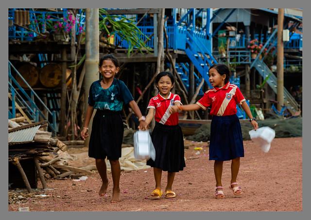 Happy girls in Kampong Phluk Fishing Village, Cambodia, Asia