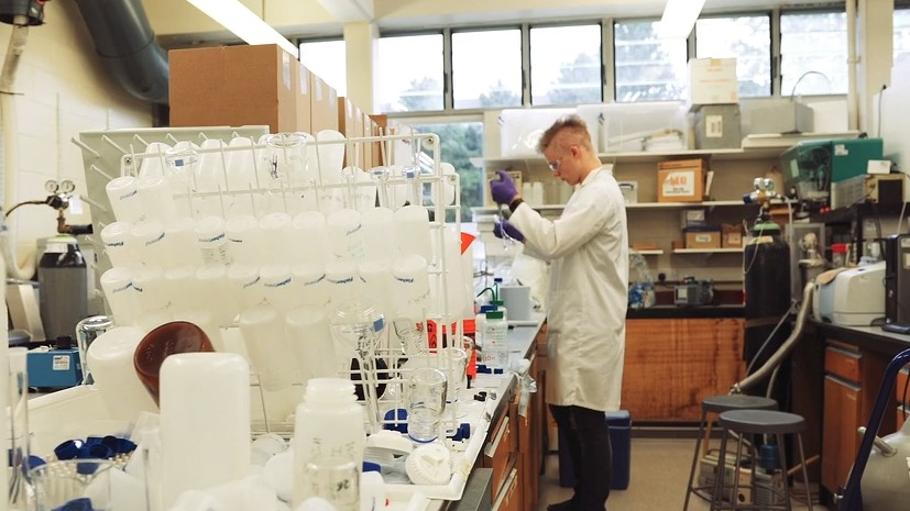Dominic conducting an experiement in a lab