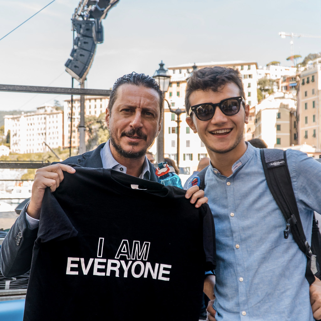 a photo of Luca Bizzarri holding Everyone's shirt