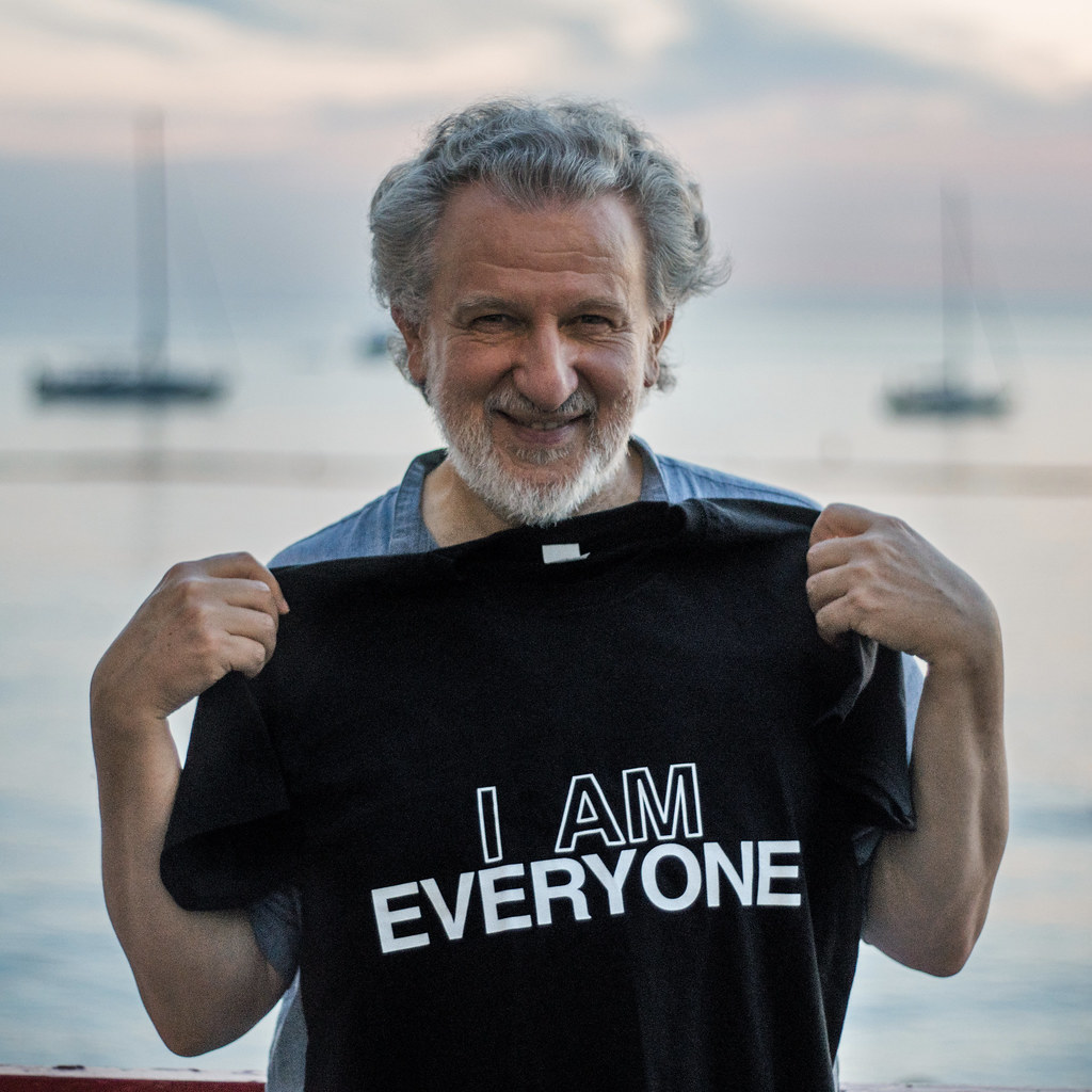 a photo of Piergiorgio Odifreddi holding Everyone shirt