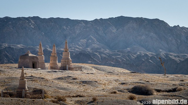 Stupa and Qilian Shan Mountains close to the Mogao caves