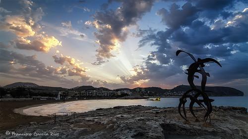 sunrise dawn alicante amanecer sunbeams moraira costablanca recesvintus franciscogarciarios sea sky sculpture beach clouds mar nubes rocks cove cape watchtower seascape landscape outdoors
