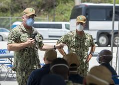 U.S. Pacific Fleet Fleet Master Chief James Honea and Adm. John C. Aquilino speak to USS Theodore Roosevelt (CVN 71) in Guam. (U.S. Navy/MC3 Dartanon D. Delagarza)