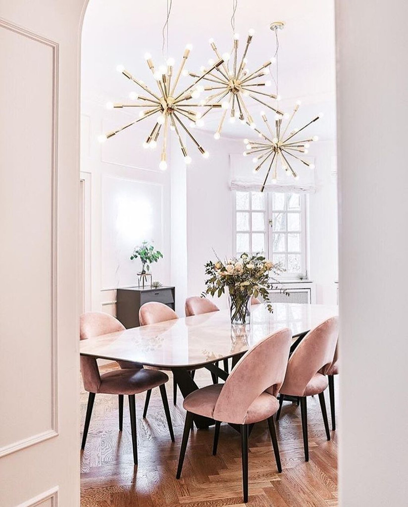 Glam Retro Airy Dining Room | Gold Sunburst Chandeliers | Mauve Pink Velvet Chairs | Velvet Dining Room Chairs | Velvet Dining Chairs | Dining Room Inspiration | Dining Room Ideas | Gold Dining Room Lighting | Dining Room Decor