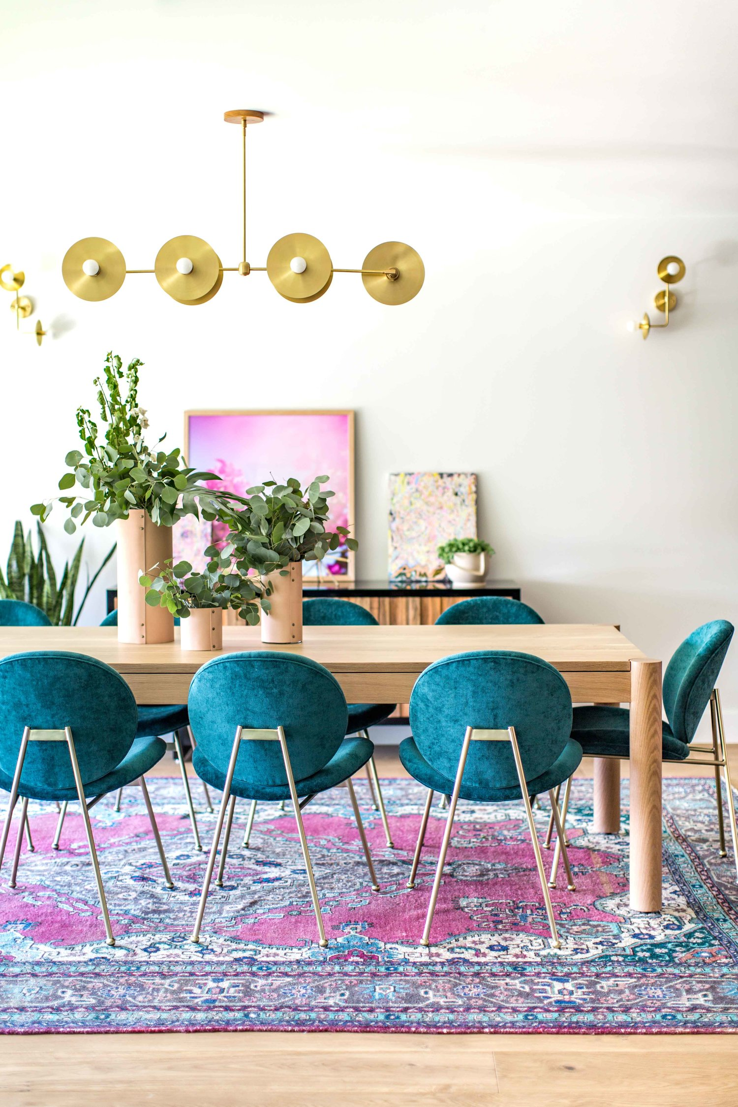 Colorful Eclectic Dining Room | Teal Velvet Chairs | Pink Teal Boho Oriental Rug | Velvet Dining Room Chairs | Velvet Dining Chairs | Dining Room Inspiration | Dining Room Ideas | Dining Room Decor | Gold Chandelier Light Fixture