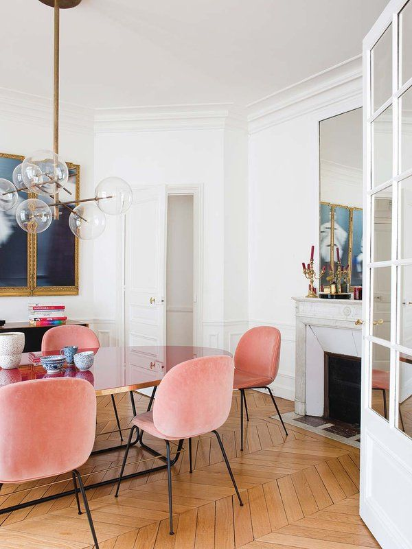 Parisian Dining Room | Clear Gold Globe Chandelier | Wood Chevron Flooring | Velvet Dining Room Chairs | Velvet Dining Chairs | Pink Velvet Chairs | Dining Room Inspiration | Dining Room Ideas | Dining Room Lighting | Dining Room Wall Art | Dining Room Decor