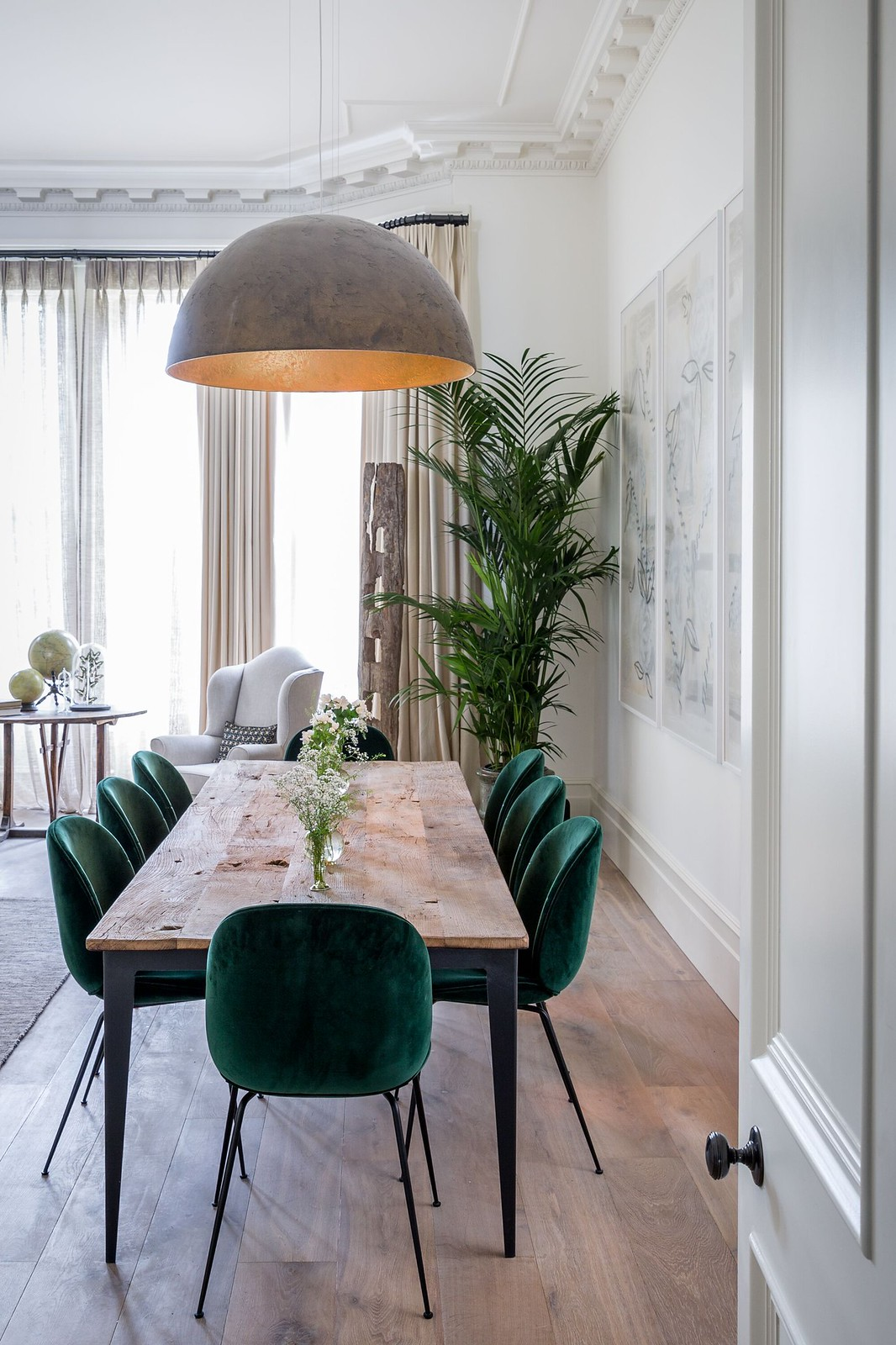 Parisian Style Dining Room | Emerald Green Velvet Chairs | Velvet Dining Room Chairs | Velvet Dining Chairs | Dining Room Inspiration | Dining Room Ideas | Dining Room Decor | Open Concept Living Room Dining Room Idea