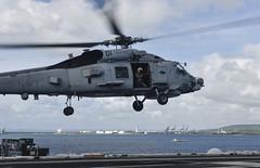 An MH-60R Sea Hawk takes off from USS Theodore Roosevelt (CVN 71) in Guam, May 7. (U.S. Navy/MC3 Julian Davis)