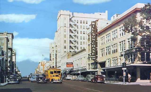 Downtown view to the west from Central Avenue at 3rd Street with Willson Chase Department Store shown along with the old vehicles and street car in Saint Petersburg, Florida, ca 1948