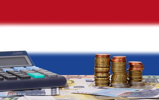 Calculator with money and coins in front of flag of Netherlands