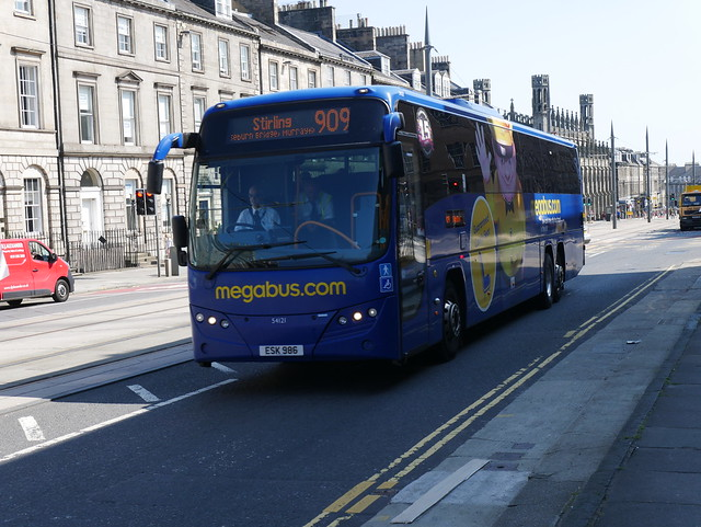 Stagecoach Volvo B13RT Plaxton Panther ESK986 54121, new as SP62CGY, in Megabus livery, operating service 909 to Stirling at York Place, Edinburgh, on 25 July 2019.