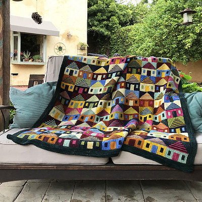 Safe at Home Blanket by Margaret Holtzmann is a colourful blanket reflecting the current reality that we are safest at home with our family.