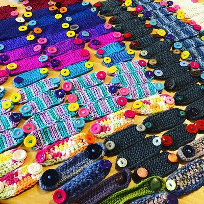 My sister knit, her friend crocheted and my niece sewed on the colourful buttons on all of the face mask straps they were making to donate!