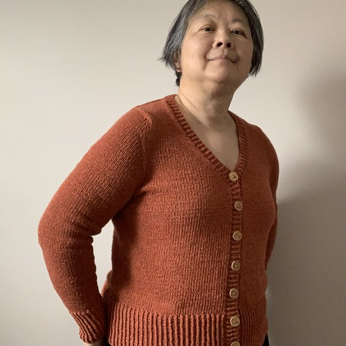 When I took these photos I hadn't blocked yet but I am happy with my finished Antonia by Cocoknits knit using Berroco Elba. Line Buttons by Katrinkles.