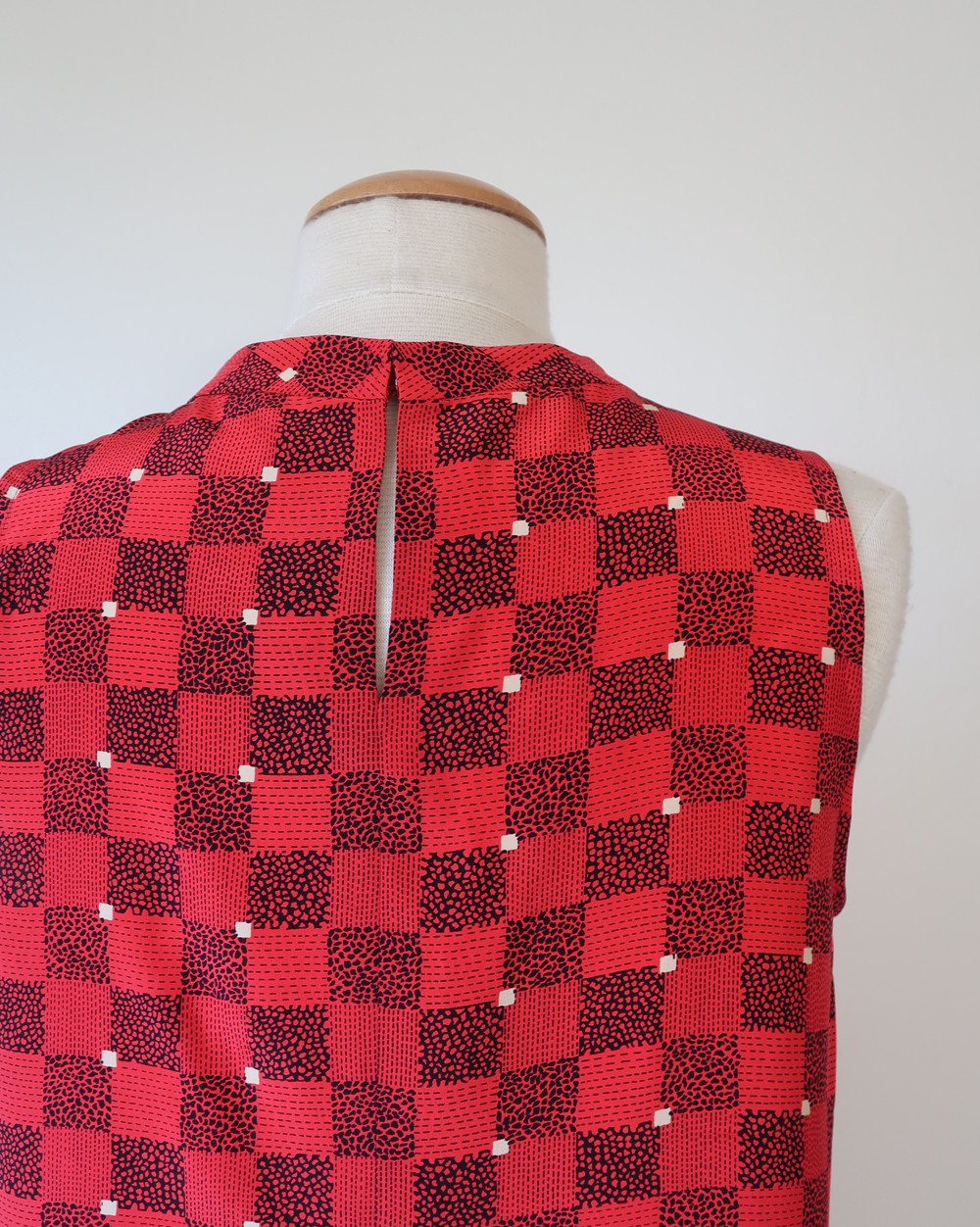 red silk top on form back seam
