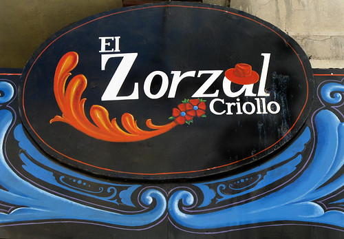Sign for El Zorzal Criollo done in Fileteado, a style popular in Buenos Aires, Argentina
