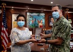 Adm. John Aquilino presents Guam Gov. Lou Leon Guerrero with the Navy Distinguished Public Service Award, May 2. (U.S. Navy/MC1 Julio Rivera)
