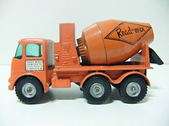 "RMJ68 posted a photo:	Nº K-13a.ERF Readymix Concrete Truck (1960´s).Orange color, Siver metal wheels and ""Readymix"" decals.Matchbox King Size Series.Lesney Products.Escala 1/50 aprox. (?)Made in England.Produced from 1963 to 1970.------------------------------------------Matchbox King Size K-13/1; ERF Readymix Concrete Truck; Orange, Readymix, silver regular wheels""This ERF 64G Concrete mixer was added to the King-Size range in 1963, it is always Orange with either red or silver regular wheels. The logo can be 'Readymix' or 'RMC', values are not affected by the version.""Source: www.chezbois.com/non_corgi/MBX_Pages/81193.htm------------Matchbox King-Size No.K-13 ERF Concrete Mixer""1963 saw the Lesney Matchbox King-Size K-13 ERF Concrete Mixer join the range at number 13, This one was always painted orange all over except for the chute attached to the back which was cast as part of the base and that was painted black, The headlights, grille and front bumper were trimmed with silver paint and the cab was fitted with clear plastic windows, The truck came with two different liveries which I believe were both for the same company, there could be either ""Readymix"" or ""RMC"" painted on to the mixer barrel and the cab doors had ""Ready Mixed Concrete Limited"" decals which usually had a white background but are known to have a clear background which allows the orange colour to show through, The wheel hubs are usually orange plastic but unpainted metal hubs were also used and both types were fitted with black plastic tyres, The model was packaged in D, E and F type boxes with the F type being window boxes, The ERF was replaced by the DAF Building Transporter in 1970/71.""Source: www.vintagebritishdiecasts.co.uk/kings/k13-1.htmMore info: www.bamca.org/cgi-bin/single.cgi?id=K013awww.bamca.org/cgi-bin/vars.cgi?lrg=1&mod=K013awww.bamca.org/cgi-bin/vars.cgi?mod=K013a&var=01-----------------------------------------------------------------------------------------ERF""ERF of Sun Works, Sandbach, Cheshire produced commercial vehicles from 1932.1932 Edwin Richard Foden retired from Foden. After a period of recuperation he returned to the development of a diesel lorry on his own account.1933 With the collaboration of his son Dennis, and several key figures dismissed by Fodens, Edwin established a rival concern, which became ERF Ltd specialising in heavy oil-engined transport vehicles from 5 to 40 tons capacity.1933 The new company used the same Jennings cabs and Gardner engines as Fodens had done.1933 The first ERF vehicle was a 6 ton type C14 which remained in production until 1946.WWII Production of military lorries, mostly for the Royal Army Service Corps, with some vehicles for essential civilian users.1950 Edwin died1951 Used steel cabs by Willenhall Motor Radiator Co1952 The oval radiator grill was introduced1954 E. R. F. (Holdings) Ltd was incorporated as a public company; Dennis Foden was chairman and managing director. Other directors were Edwin Peter Foden, George Faulkner, works manager, and Ernest Sherratt, chief designer. Mr E. P. Foden was deputy managing director1961 The LV cab was introduced. The company employed 315 persons.1961 Manufacturers of commercial motor vehicles. 315 employees. 1967 Fire appliances were produced, a situation which continued for ten years until taken over by Jennings1970 Changes to the A range1973 Developed the SP cab for vehicles up to 42ton gvw1974 The B range introduced1996 Company bought by Western Star of Canada1999 Acquired the Marshall bus-building business.2000 MAN of Germany acquired ERF from Western Star[ ""Source: www.gracesguide.co.uk/ERF"