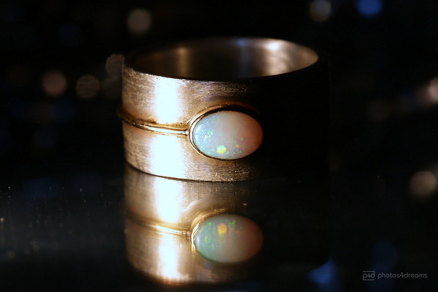 one of my first handmade rings with a white opal
