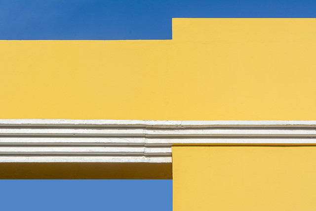 Yellow building with white stripes