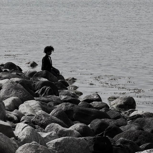 Boy on rocks. Ribersborgsstranden. Malmö. Sweden. 2020.