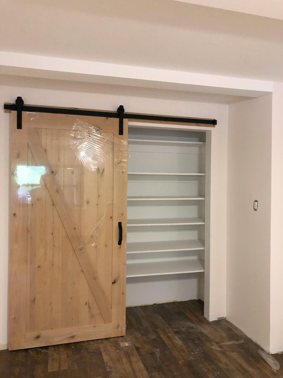 Barn Door Sliding Closet Door | Farmhouse Interior Door | During Master Bedroom Renovation Photos | Parquet Floors | New York One Bedroom Apartment Reno | Before & After: Feminine Chic Bedroom Renovation