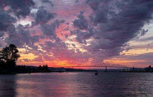 sunset twilight bridge lewisandclarkbridge red reflections water river oregon rainieroregon spring
