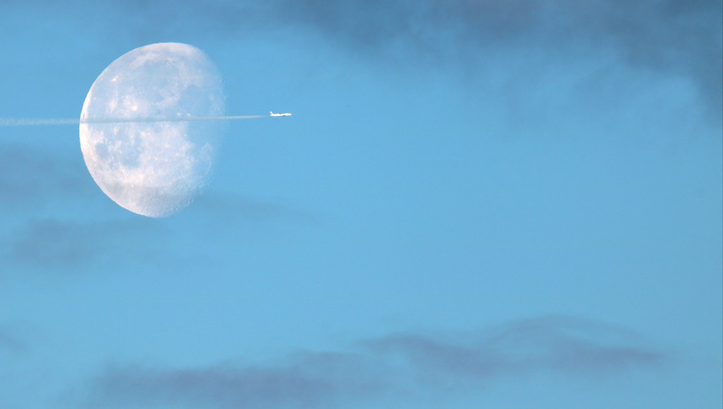 Waning Gibbous Moon with airplane fly by - May 10th/11th, 2020
