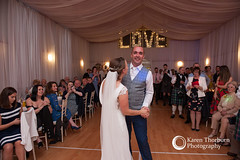 Bride and groom's first dance in village hall
