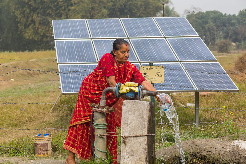 A farmer with her solar irrigation pump in Nepal Balahar Daha Village, Saptkoshi Minicipality, Saptari District of Nepal.