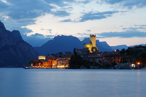 architecture beauty in nature castle colour image dusk famous place fortress horizontal idyllic italian culture italy lake garda landscape malcesine medieval mountain range no people outdoors photography scenics sky summer sunset town tranquil scene travel destinations veneto water