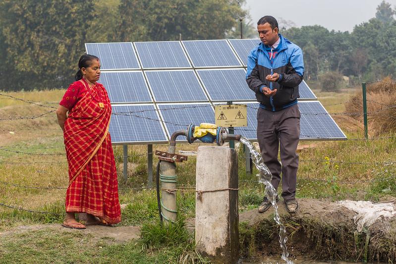 A woman farmer with her solar irrigation pump in Nepal Balahar Daha Village, Saptkoshi Minicipality, Saptari District of Nepal.