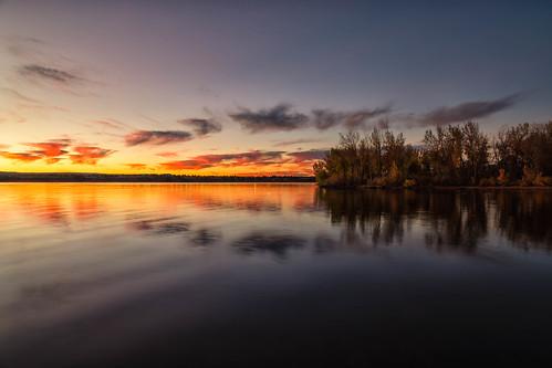 sunrise dawn daybreak morning landscape reflections chatfieldstatepark colorado trees silhouettes clouds lake