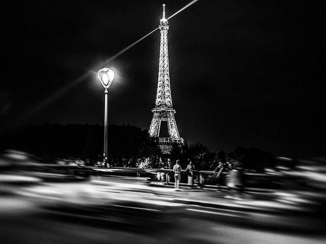 Eiffel Tower with Photographers and Traffic