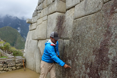 Guiterrez examining stones. From History Comes Alive at Machu Picchu