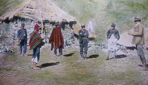 Handpainted image of Hiram Bingham interviewing local governor and residents. From History Comes Alive at Machu Picchu
