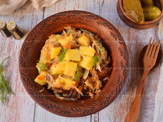 Stewed cabbage with potatoes and mushrooms