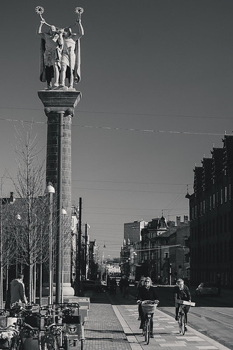 architecture citysquare copenhagen denmark urbanlandscape statue people pavement sidewalk cyclist cyclists urban europe bw bnw blackandwhite monochrome canon7d travelphotography canonef24105mmf4l
