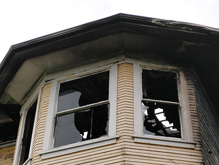 Broken windows in a burnt-out house