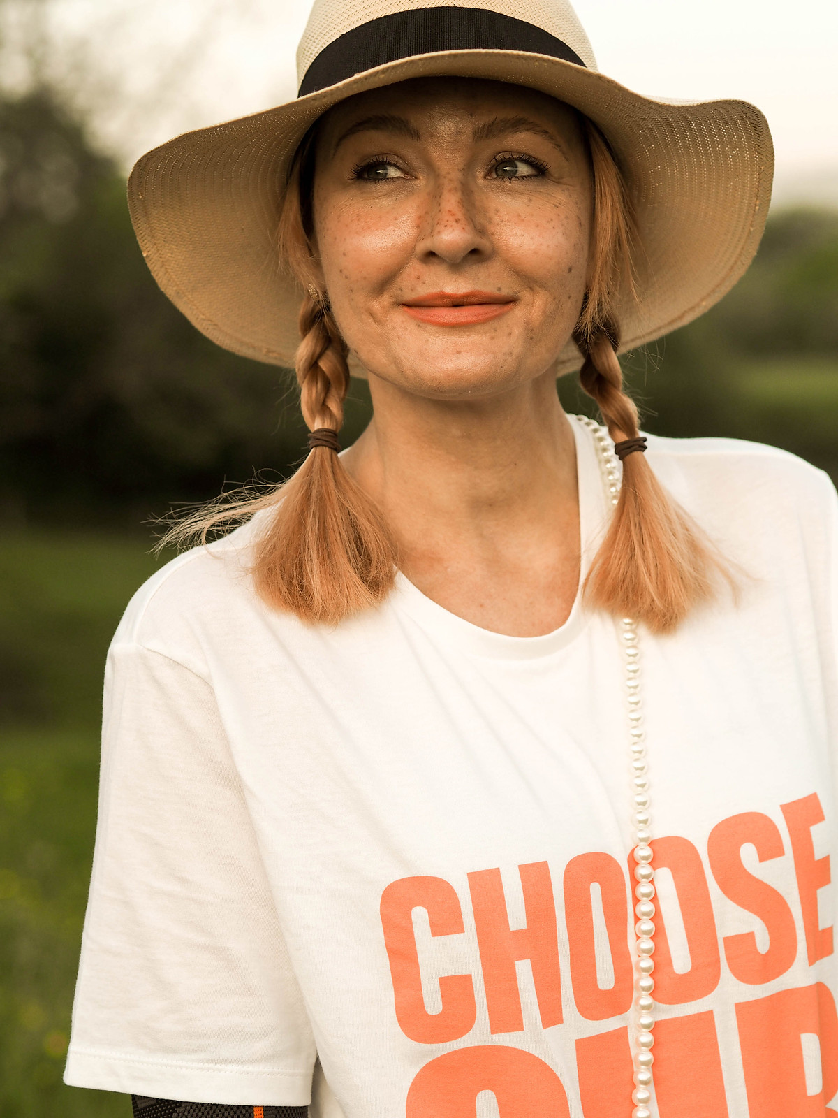 Styling the Charity 'Choose Our Carers' T-Shirt (With snake print wide leg pants and a straw hat) | Not Dressed As Lamb, over 40 style
