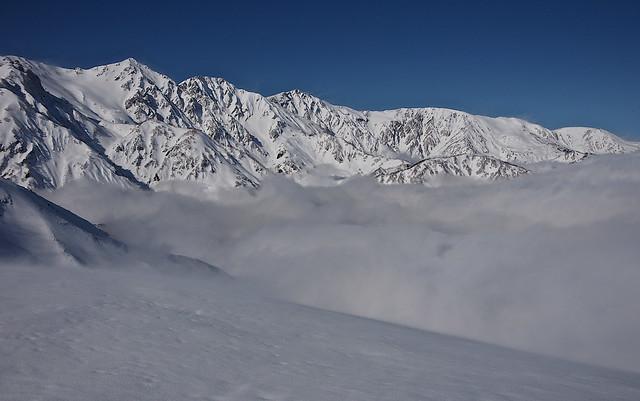 Snow ridge above a cloud 6