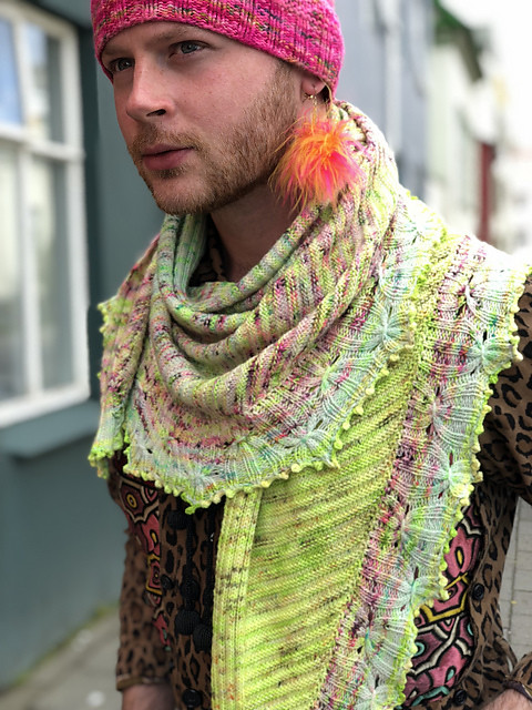 Smock It by Stephen West is a colourful shawl knit sideways using three colours with a picked up border