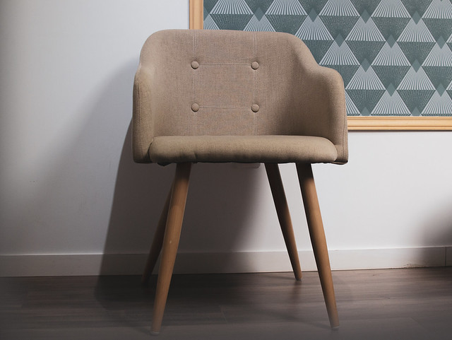 Brwon designed chair on cosy background