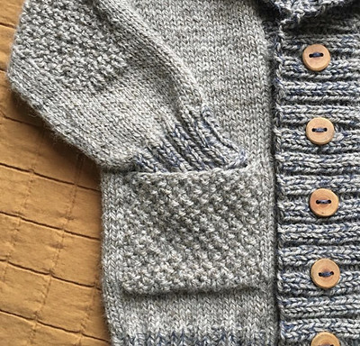 Victoria finished this awesome cardi for Elliot with arm patches and pockets to carry important things, like rocks or possibly cars! Pattern is Elevenses by @frogginette (Lisa Chemery). West Yorkshire Spinners BFL Aran and Shibui Tweed Silk Cloud