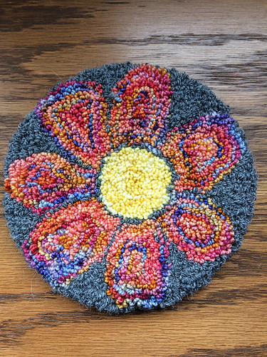 Kathy has been trying her hand at needle punch! This is her Flower coaster.